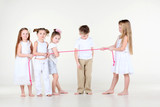 Four little girls draw over pink rope and boy