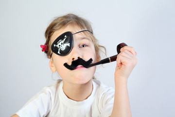 Little girl in white with pipeful, fake mustache