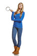 Full length of young female holding magnifying glass