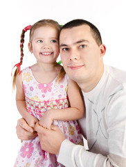 Smiling little girl with her father isolated