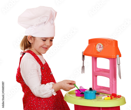happy little girl play cooking