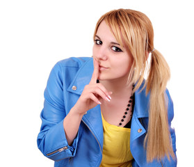 teenage girl making silence gesture on white