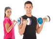 Young couple exercising with weights together