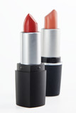 Two lipsticks on a white background