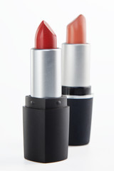 Two lipsticks on a white background
