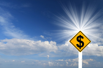 Yellow Rhombus Road Sign With Dollar Sign Inside On Blue Sky Bac