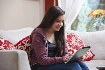 Teenage girl on tablet pc
