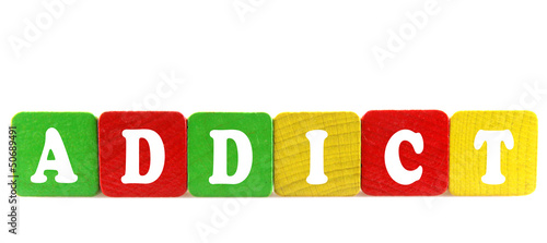 addict - isolated text in wooden building blocks