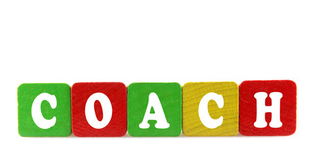 coach - isolated text in wooden building blocks