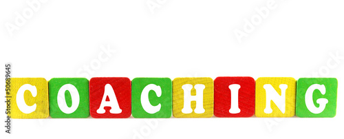 coaching - isolated text in wooden building blocks