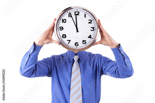 Young businessman with analog clock. Deadline concept.