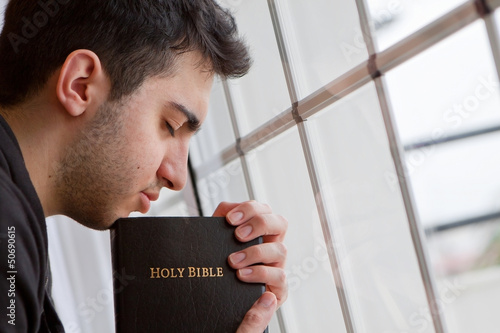 Man Praying by Window