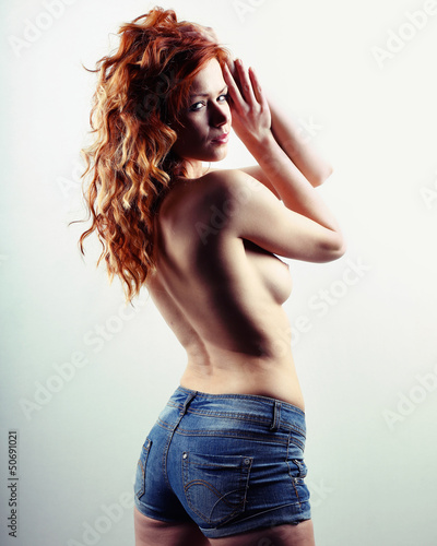 a very beautiful topless woman in short jeans denim