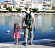 Father and daughter looking into water