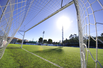football or soccer goal and blue sky in the stadium