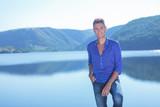 man posing by the lake