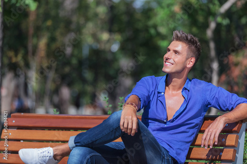 man on bench looks away