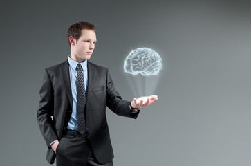 Man holding brain Hologram. Futuristic technology concept.