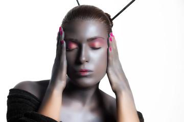 Beautiful Zen Woman. Creative High Fashion Makeup. Isolated