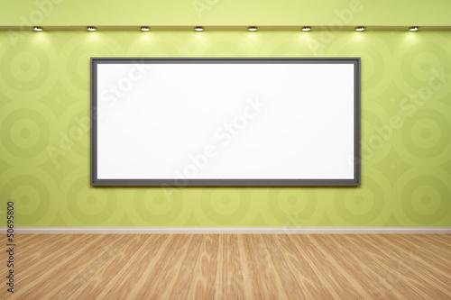 Bilderrahmen auf grüner Wand beleuchtet