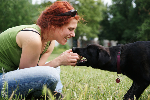 canvas print picture Young woman playing with her dog