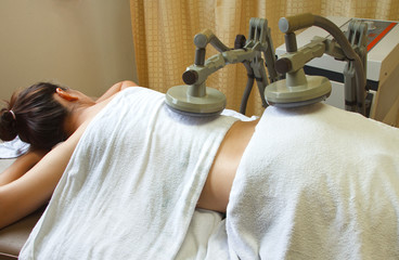 physical therapy,woman treatment with shortwave diathermy