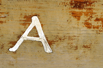 Background yellow pine with a letter A