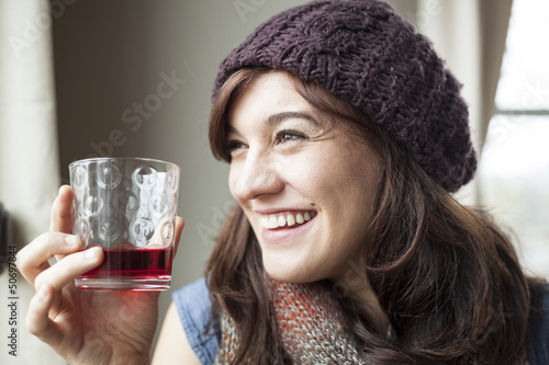 Beautiful Young Woman Drinking Glass of Cranberry Juice - 50697844