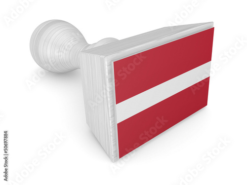 Wooden stamp with latvian flag.