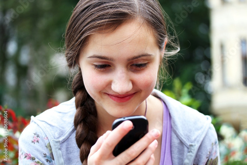 Happy girl with a mobile phone