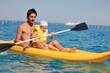 little boy with his father in the yellow boat floating on the se