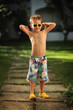 wonderful emotional little boy posing outdoors in summer