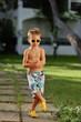 wonderful emotional little boy posing outdoors in summer