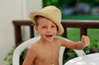 hot summer day poses little boy in straw hat