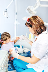 Dentist showing toy teeth