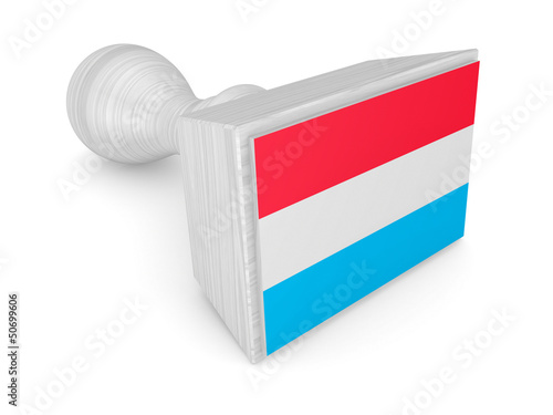 Woden stamp with luxembourgian flag.