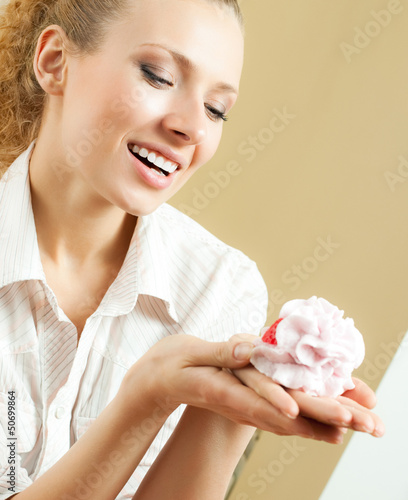 Cheerful smiling blond woman eating cake