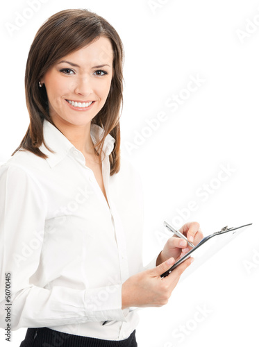 Happy businesswoman writing on clipboard