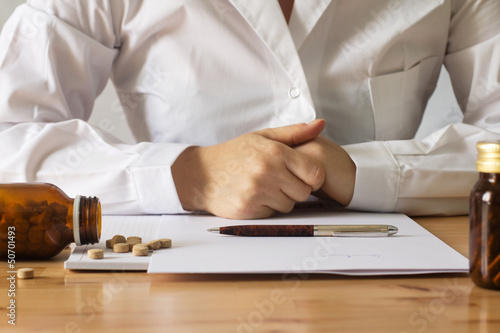 doctor detail with pills and prescription