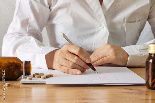 doctor writing a prescription