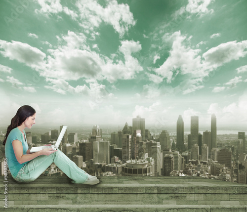 Young woman with laptop computer.