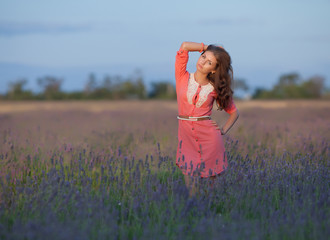 Young woman in the field of blossoming lavender