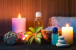 three candles , towels , salt, oil and stones