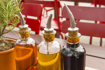 balsamic vinegar bottles and condiments on the table in an open