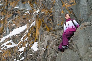 Girl climbs the rocks