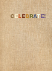 Celebrate word on linen background