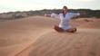 Woman doing yoga in the wilderness at sunset against a beautiful