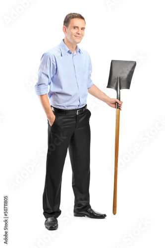 Full length portrait of a young man holding a shovel