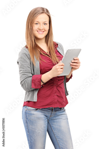 Young female holding a tablet and looking at camera