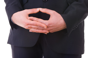 Business man waiting with folded hands.